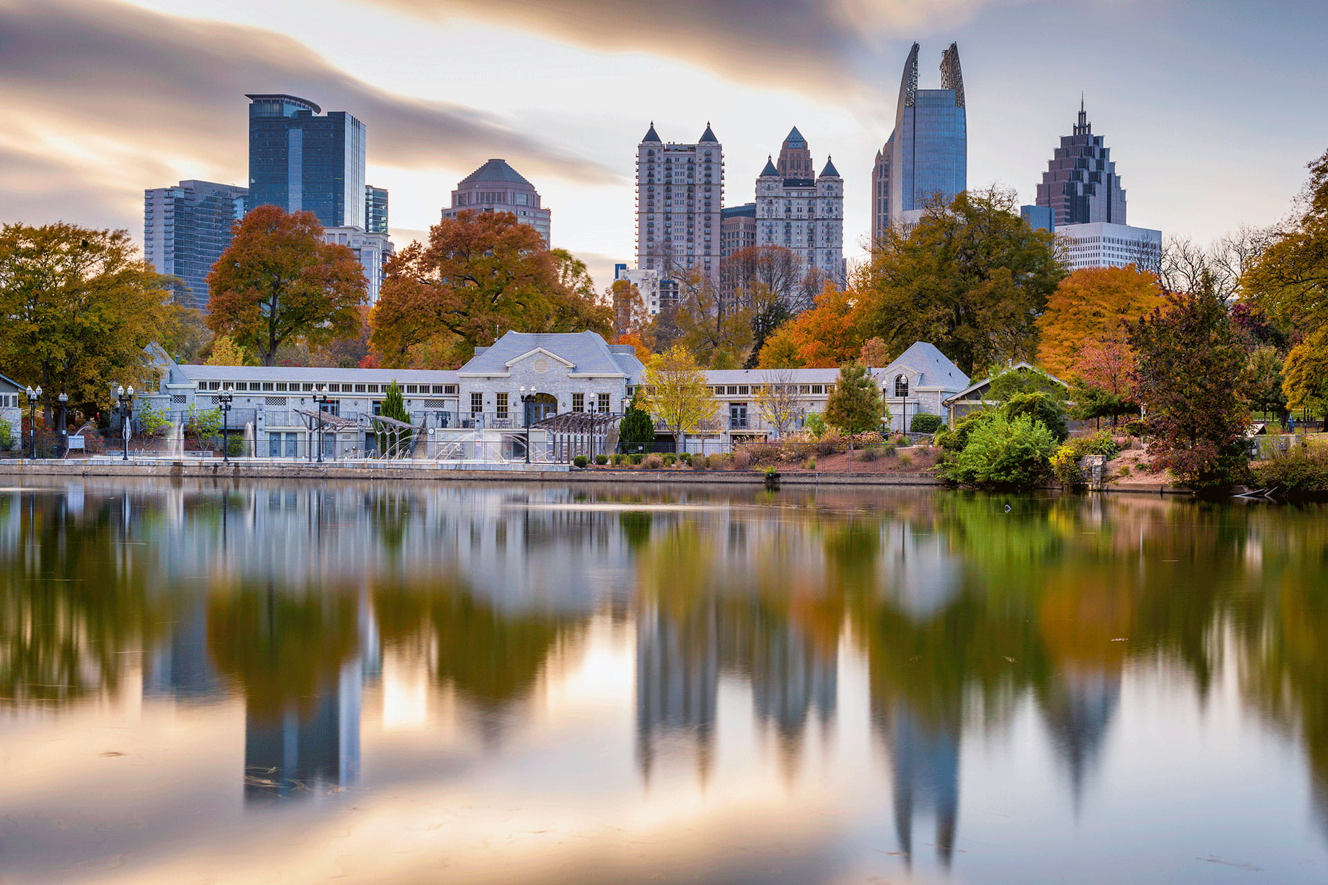 Lakefront Atlanta cityscape during fall