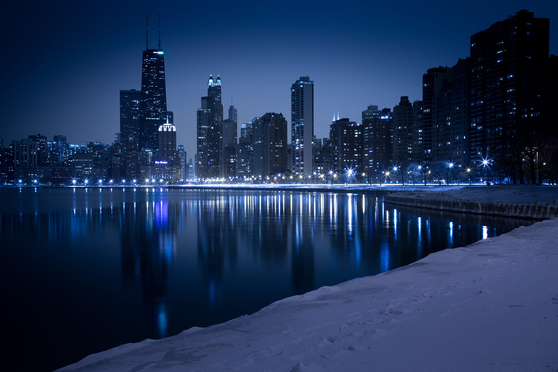 Blue and Black Chicago Skyline at Night