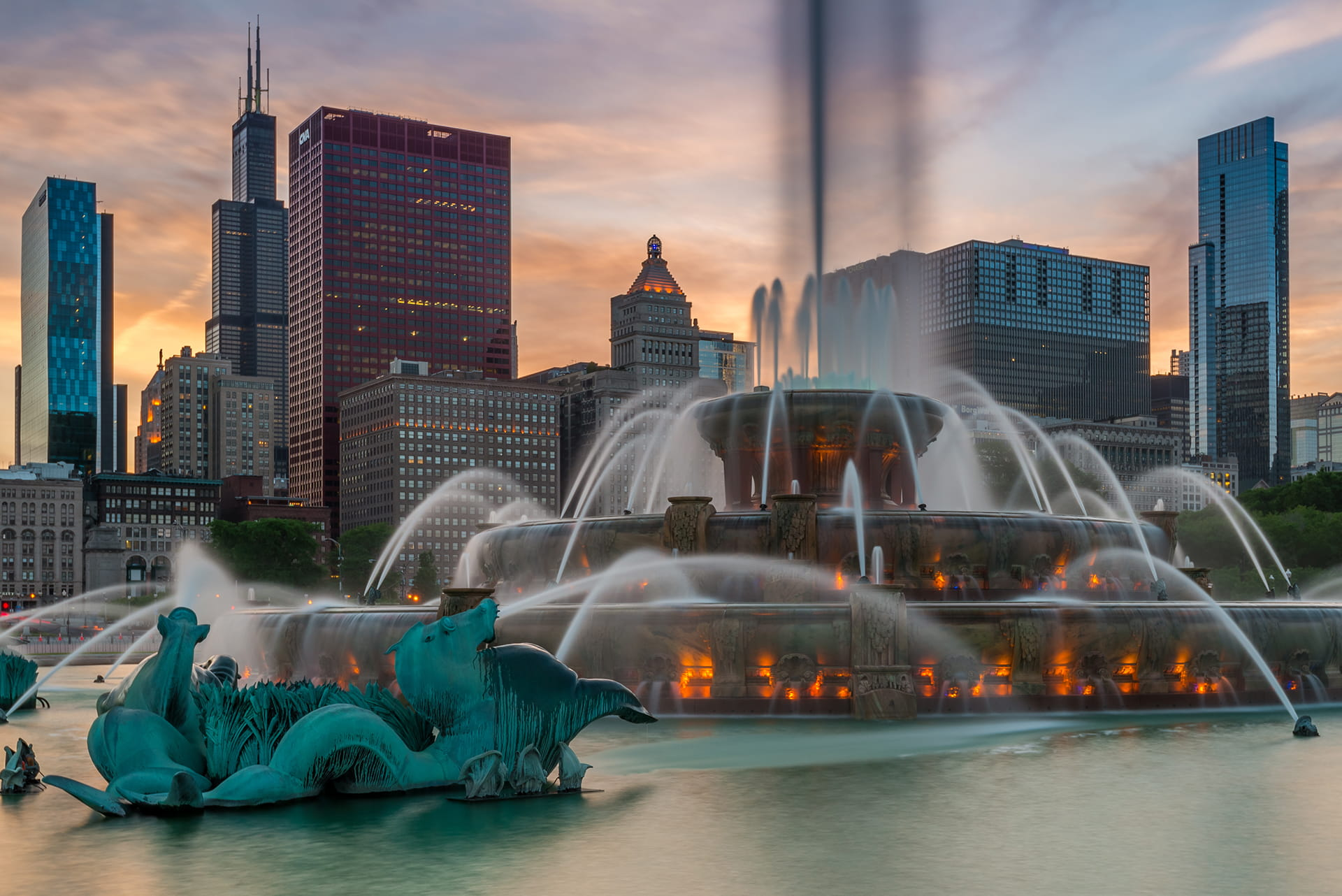 Chicago, Buckingham Fountain and skyscrapers against evening sky