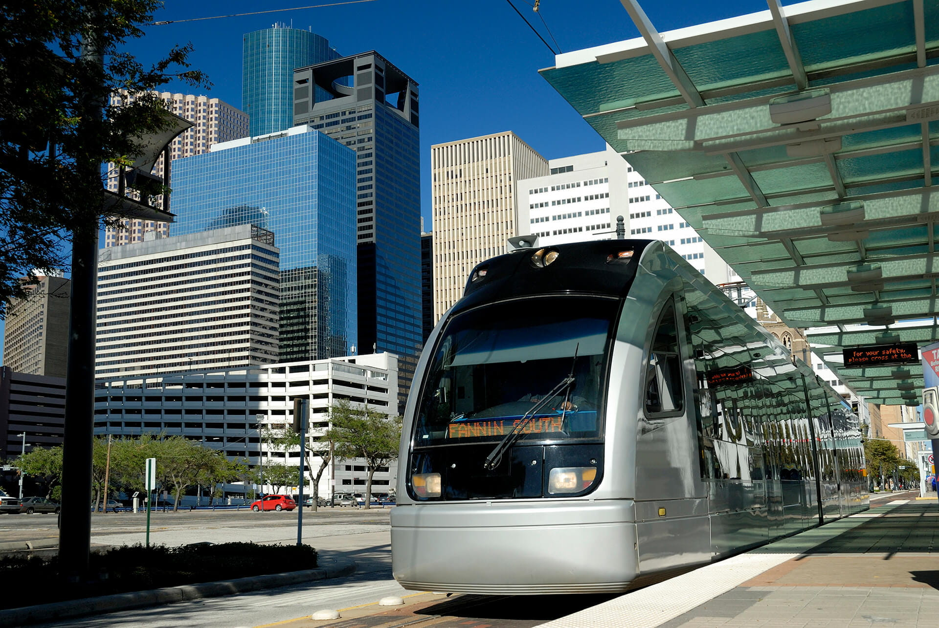Metro Train at Platform With Modern Skyscrapers In Background