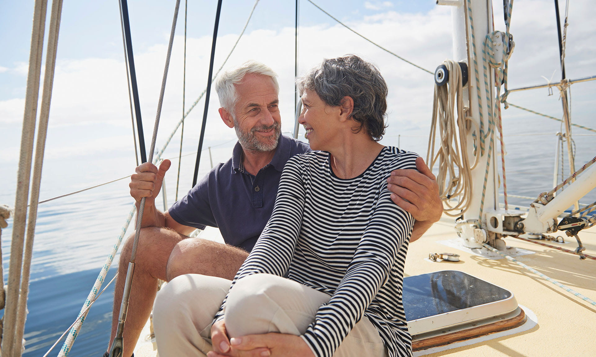 Elderly Couple Sitting on boat deck