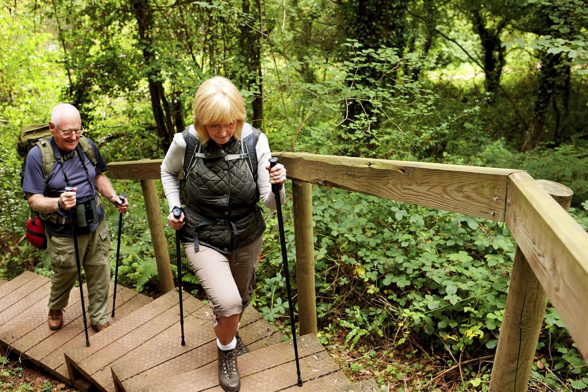 Two elderly hiking