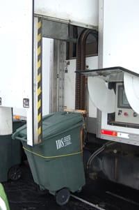 Green bin being loaded for Earth Day item shredding.