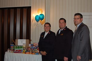 Goldsberry Wealth Strategies team in front of donated food items.