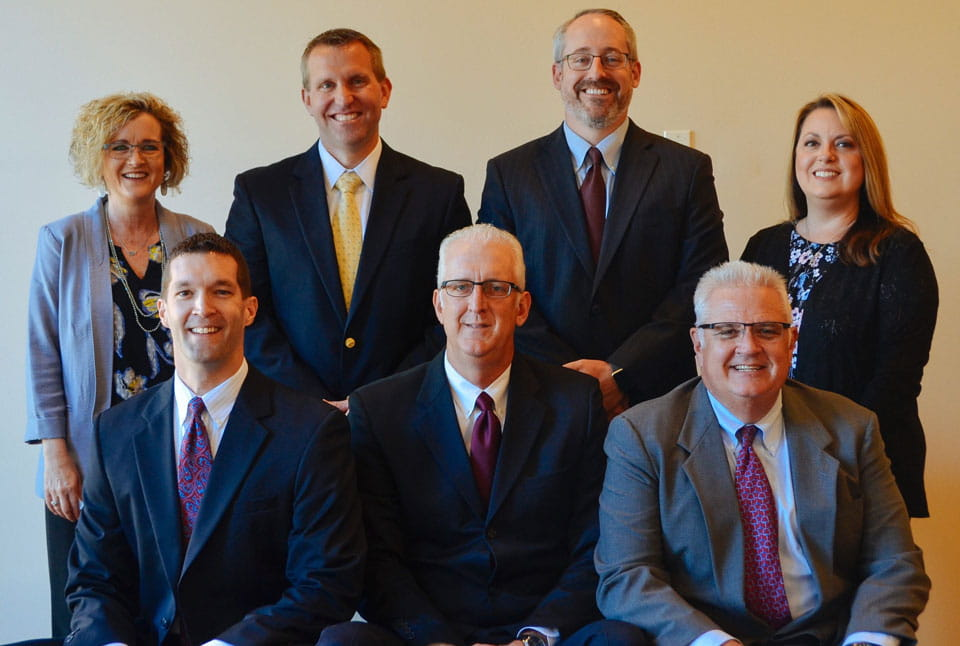 Goodwater Wealth Management Group team photo. (top row from left to right: Jaynie Guerrero, Greg Bowden, Doug Noble and Angie Spinner. Bottom row from left to right: Jason Smith, Rod Dahl and Joe French.)