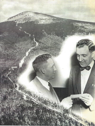 George Mendall sells his first share of Sugarloaf stock to then Governor Edmund Muskie.
