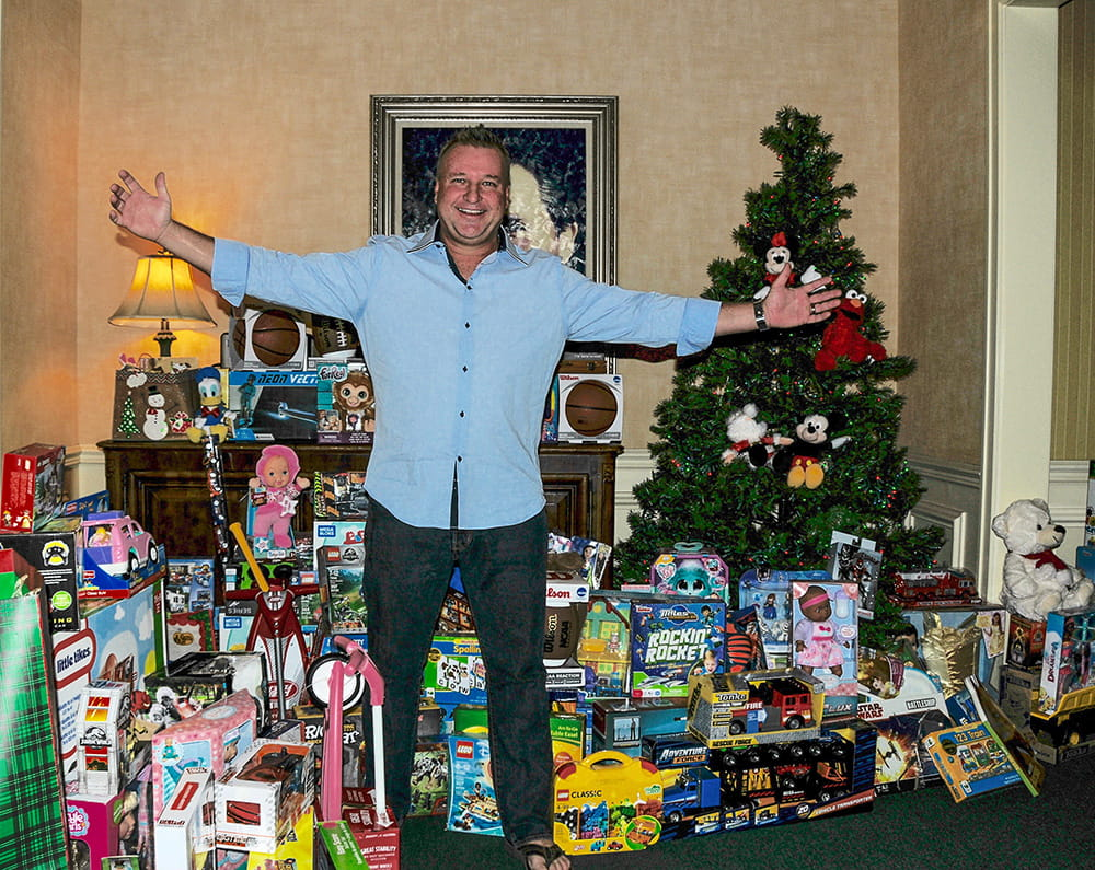 Mick with toys and Christmas tree