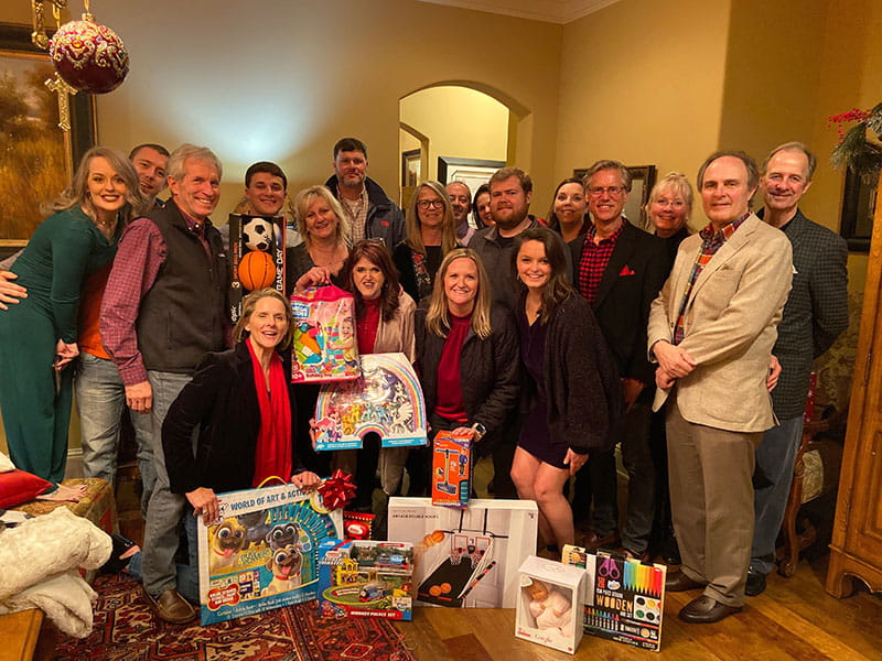 Raymond James at Halcyon Pointe collected toys for Catholic Services non-profit organization at this year's Christmas party.