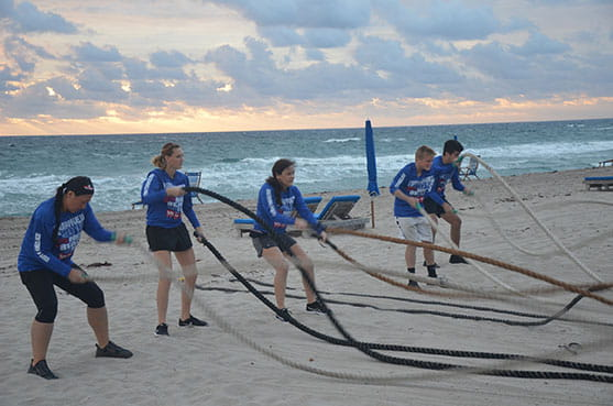 Participants performing ropes action