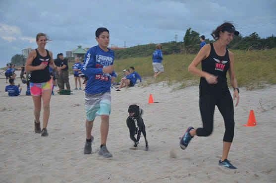 Dog chasing bootcamp participants