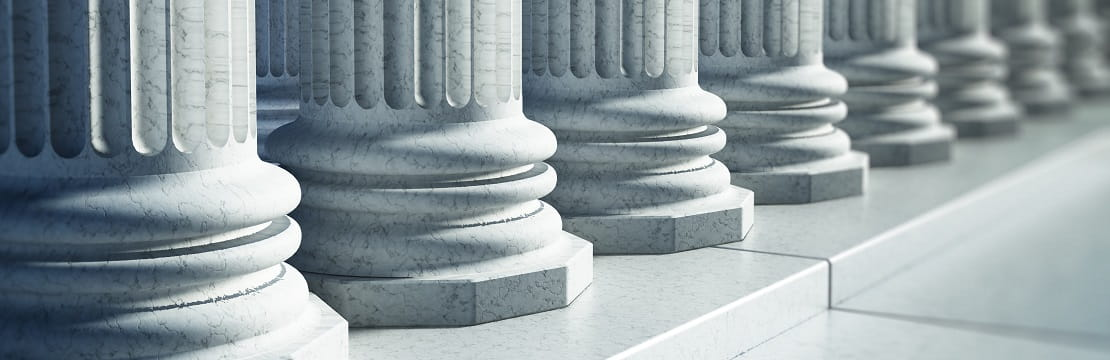 The base of several large marble columns.