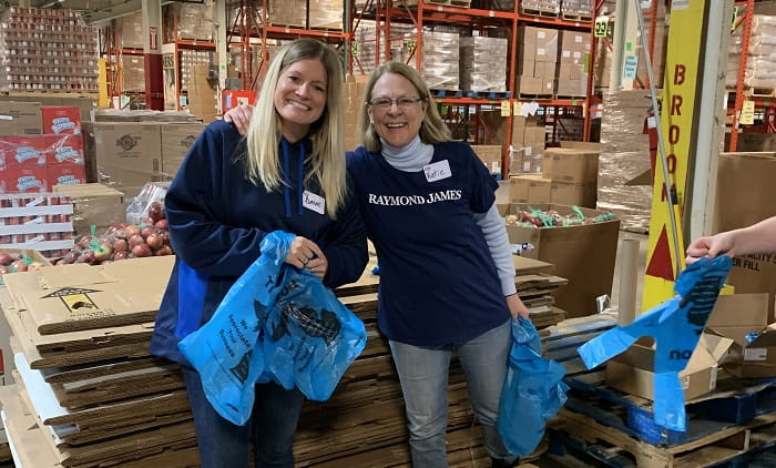 Raymond James associates volunteer with Gleaners Community Food Bank