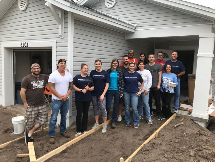 Raymond James Bank associates volunteer with Habitat for Humanity