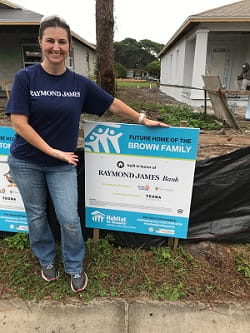 Raymond James Bank associate at Habitat for Humanity build