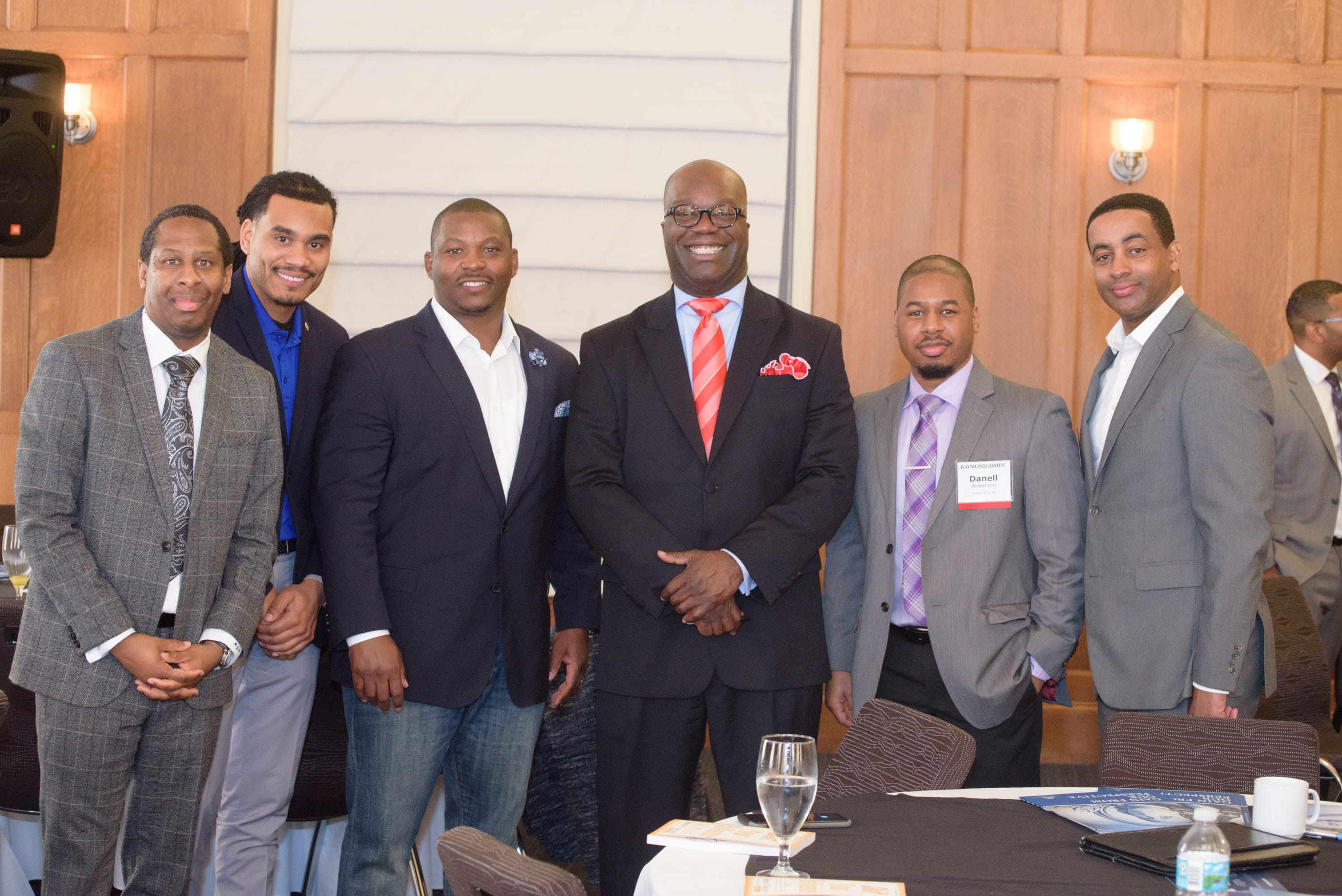 Simon T. Bailey (third from right) speaks to the men and women of BFAN (Black Financial Advisor Network) at Raymond James.